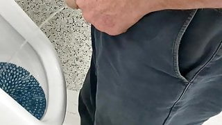 Moustached grandpa pissing