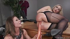 Domme in latex anal toys busty blonde