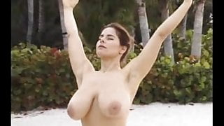 Huge boobs stretches on beach