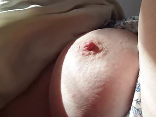 Super shine breast - Sun shining in on her big nipple breast