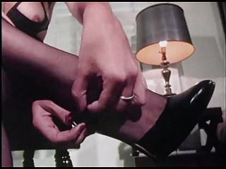Severe man to man bondage Hurdy gurdy man - bondage captive in stockings heels tied