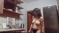 Nude MILF spied on in her kitchen