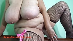 Sarah with massive hanging tits rides a big dildo