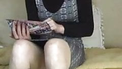 milf in boots playing on couch