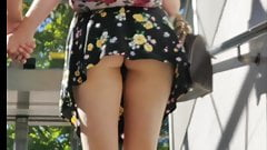 Tall blond teen upskirt wearing high heels, miniskirt, thong