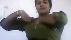 Busty Tamil aunty showing herself to neighbor boy