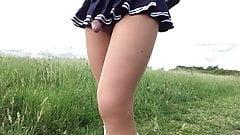 A walk in public park in schoolgirl skirt