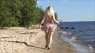 Sexy lady does striptease on the beach