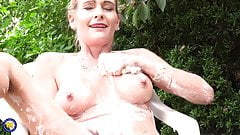 Sexy MILF feeding her pussy covered in foam