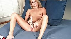 Flat chested blonde MILF masturbates with her vibrator