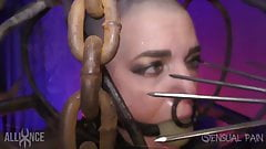 Shaved slave in cage with massive ball gag