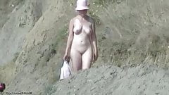 Red hat walking to the beach naked
