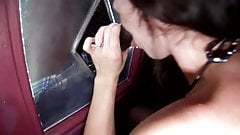 Hot wifes blows strangers in a glory hole booth