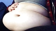 Nice BBW talks about her full belly and rubs and wiggles it