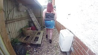 curvy Wife in Denim miniskirt flashing in the yard