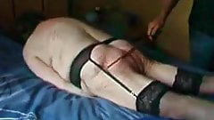 Old slut makes herself cum while caned