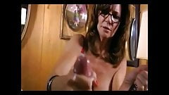Hot breasted dominant MILF with glasses milking slave