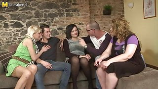 Two guys fucking three mature step moms in group sex