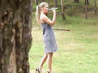Outdoor piss girl Blonde in short dress pisses outdoors