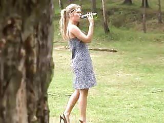 Girls pissing outdoor - Blonde in short dress pisses outdoors