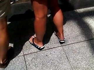 Big sexy tanned titties Candid sexy tanned legs and feet in flip flops