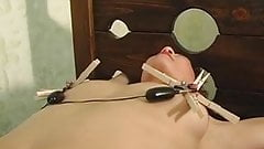 Dominatrix ties up her girlfriend and pours hot wax on her