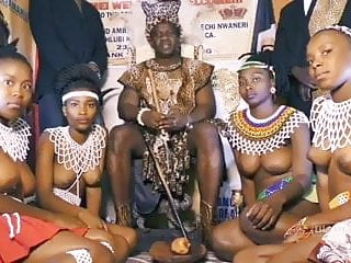 Chief vintage African chief with his own topless girls