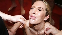 Lusty Lexi Ryder takes facials in a bukkake