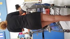 Lady wearing short skirt in grocery store line p2.2