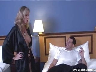 Dick stroking pictures Sexy milf strokes a young dick