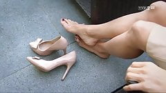 Removing her pumps sensually
