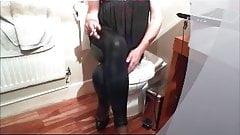 Teasing in Wet Look Leggings