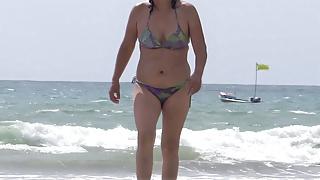 Mature wife enjoys sex on the beach, full cumshot