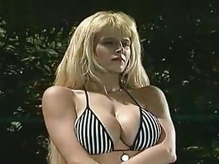 Sexy blonde in bikini - Sexy blonde teases.