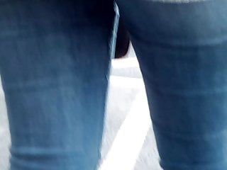 Sexy blue jeans - Young sexy girl in blue tight jean waiting at a bus stop 1
