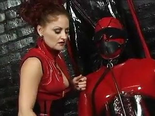 Free sex torture stoies - Red and black latex dominatrix bdsm torture play in this sex dungeon