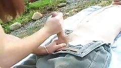 Girl gives handjob outdoors
