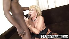 Granny in stockings teases the camera before interracial