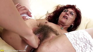 Deep fisting for sexy mature stepmom's hairy pussy