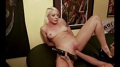 Horny blonde is fisted in front of men by a woman