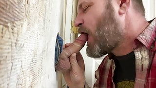 Blowing an excited guy at the gloryhole
