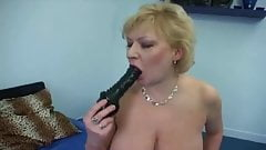 Mature Hottie with a Long Black Dildo