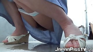 Japanese women expose pussies while peeing in public