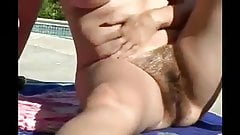 chubby mature shows her hairy pussy in the sun