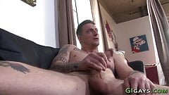 Tattooed muscled soldier tugs his cock