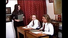 two schoolgirls punished by a female teacher in detention