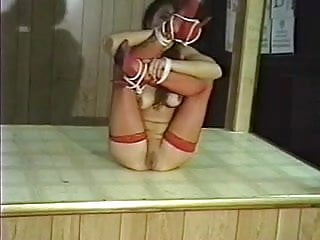 Asian tied bound gagged Sexy asian in red fishnets bound and gagged by her master