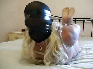 Using bondage hoods - Stocking hood hogtie.