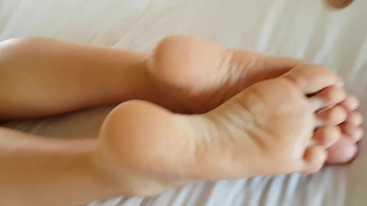 feet The soles of her