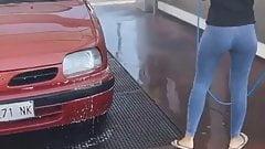 Italian girl washes the car in flip flops